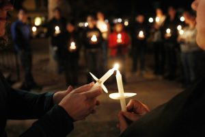 Members of Queer Advocacy Network join with St. Paul's Church of Christ Thursday evening for a candlelight vigil. Andy Carpenean/Boomerang photographer