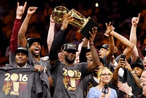 Jun 19, 2016; Oakland, CA, USA; Cleveland Cavaliers forward LeBron James (23) and the Cleveland Cavaliers celebrates with the Larry O'Brien Championship Trophy after beating the Golden State Warriors in game seven of the NBA Finals at Oracle Arena. Mandatory Credit: Bob Donnan-USA TODAY Sports